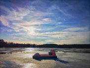 Ice fishing hovercraft resting on frozen lake