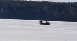 Frozen lake, flying a hovercraft, ice fishing