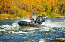 Personal hovercraft on rapids river